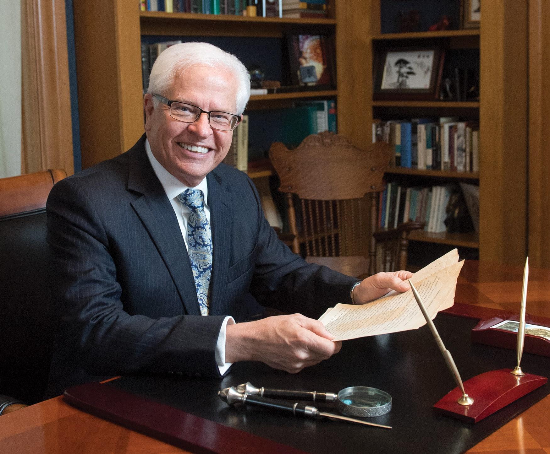 Dr. Bill Ellis at desk