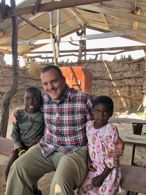 Dr. Craig Younce with Zambian children
