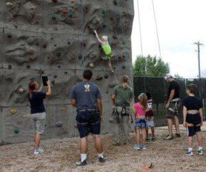 Young scholars rock climbing.